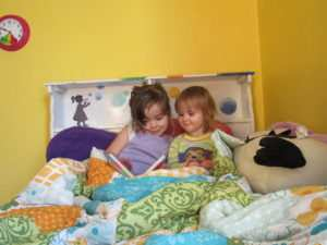 Kalie and Anja reading in bed